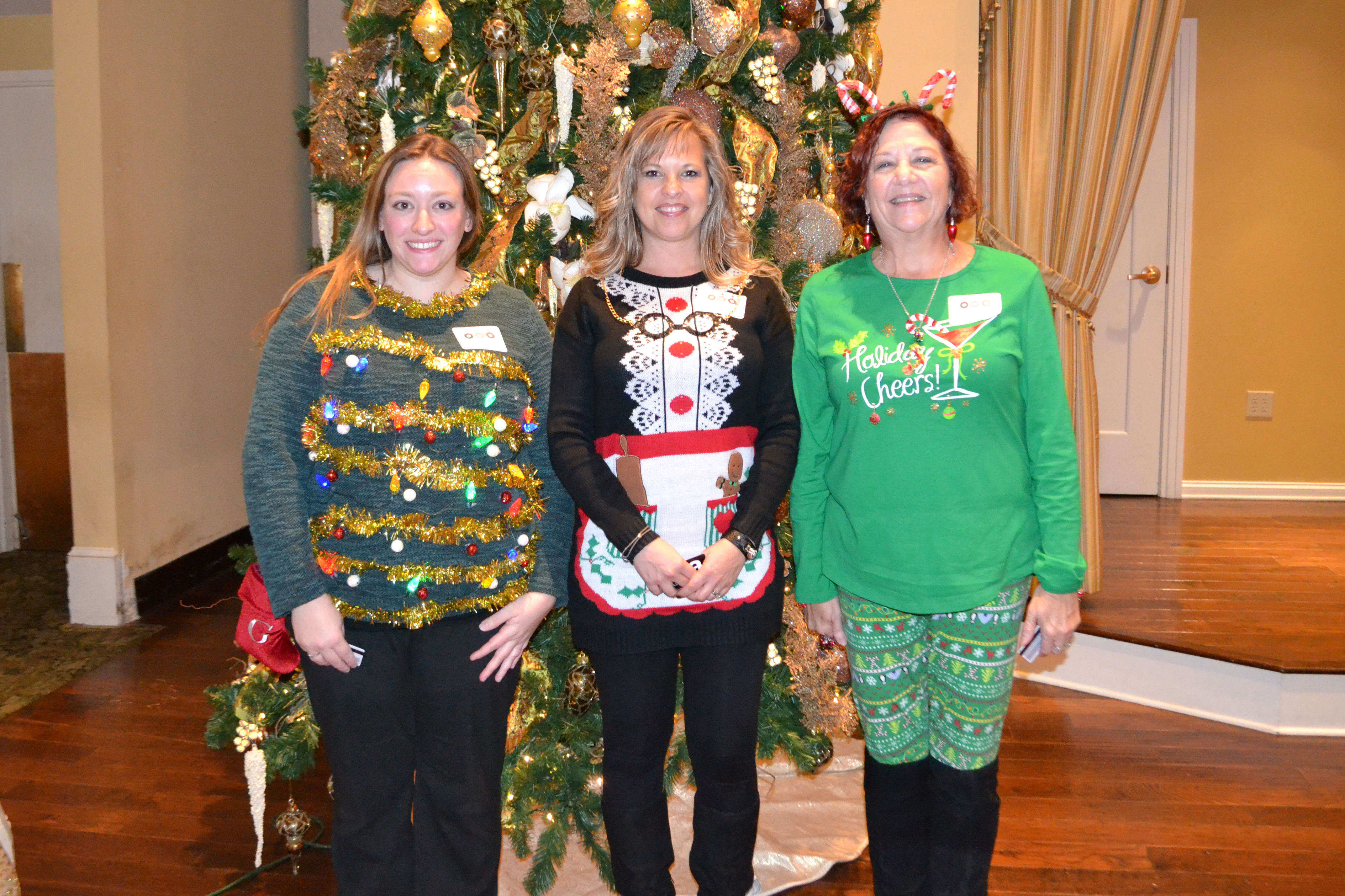 Photo of Ugly Sweater Contest WInners at the Bell Christmas Party